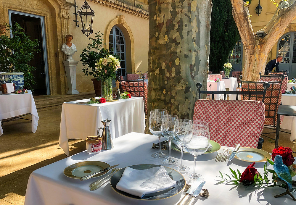 The terrasse at Villa Gallici, set for lunch