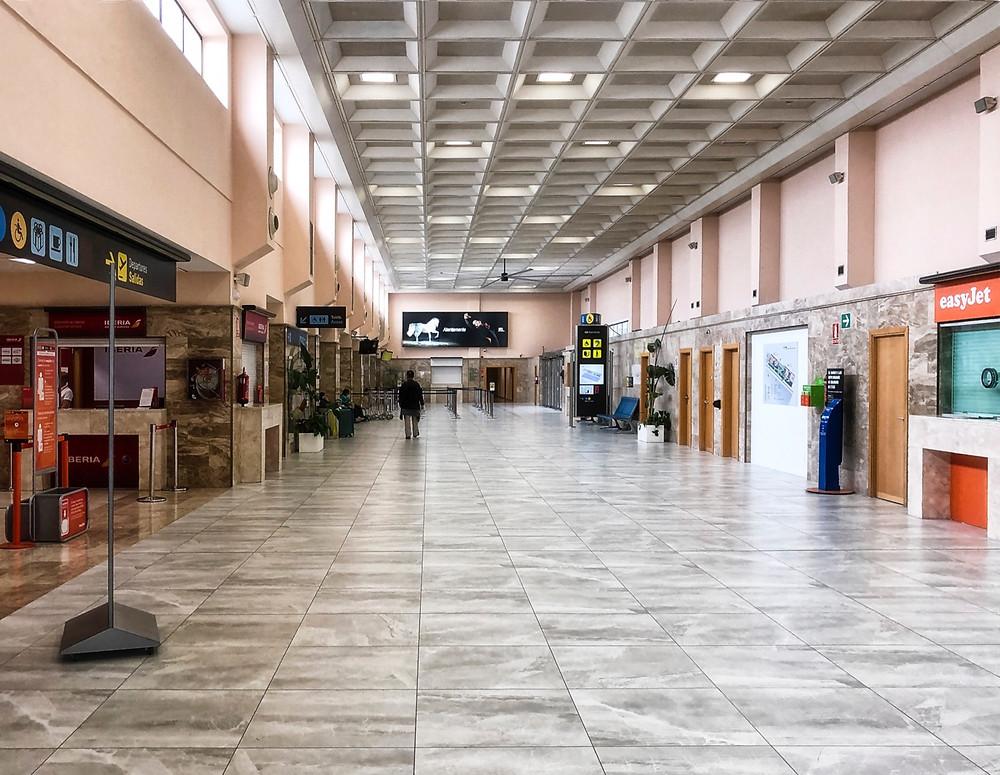 Deserted halls of the Federico García Lorca airport in Granada