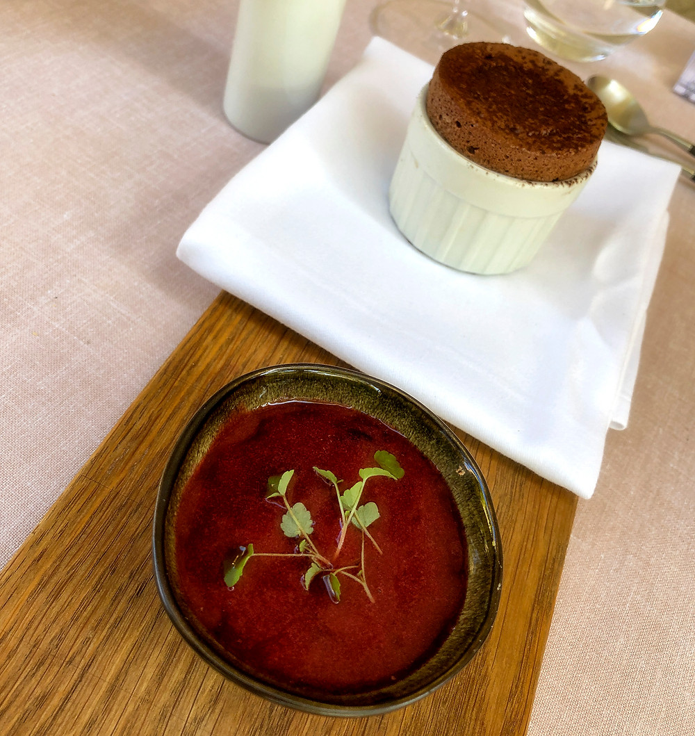 Hot chocolate soufflé dessert course