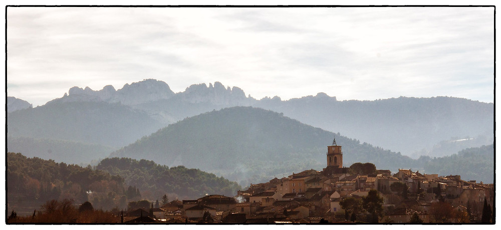 Sablet, its clock tower, and the Dentelles de Montmirail