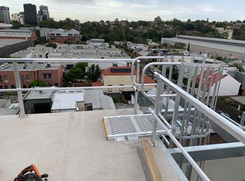 Fixed Access Ladder. Guard Rails. Roof Walkway.