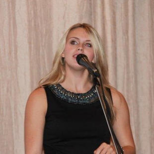 """Krista Earle performs at """"Inspired to Hire"""" at the The Grand Banquet & Convention Centre, Mississauga. 2013."""