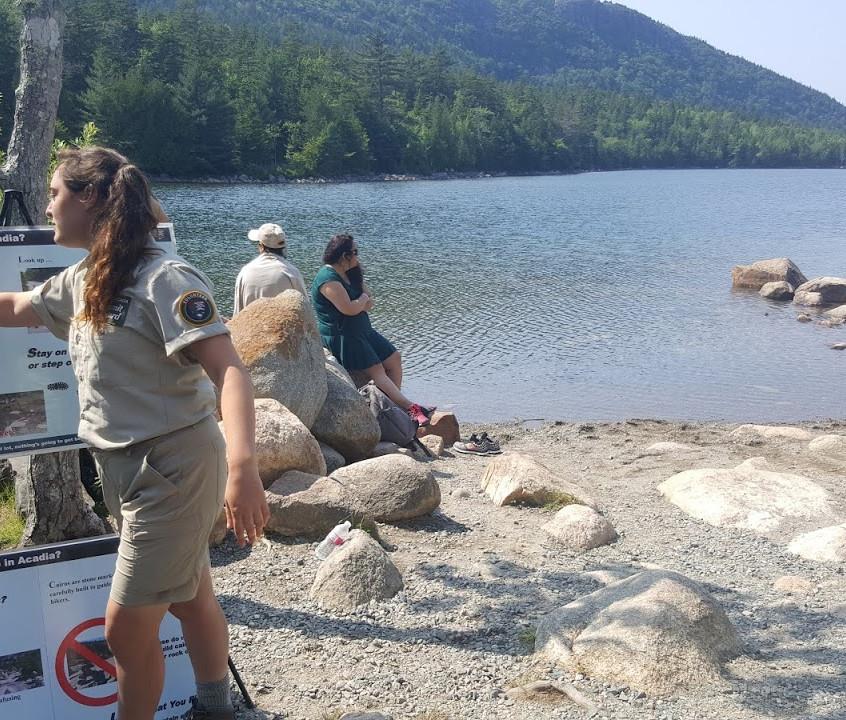 A national park ranger give us information about rules of the park. Jordan Pond, Acadia National Park, ME.