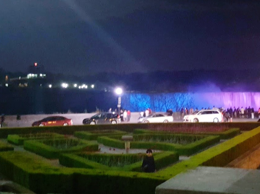 Illuminated falls at night.