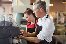 Barista making cup of coffee at the cafe