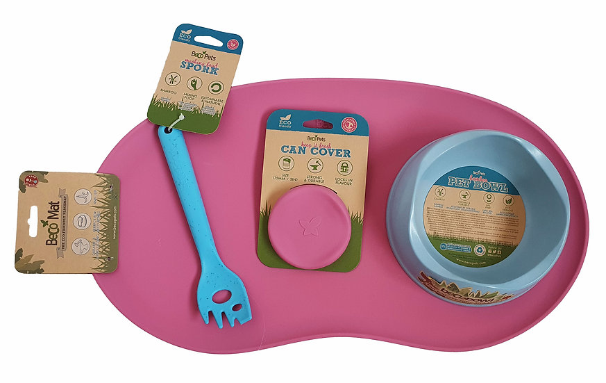 Dog food mat with food bowl, spork and can cover displayed on top.
