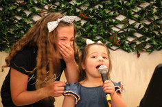 Two year old singing at Open Mic