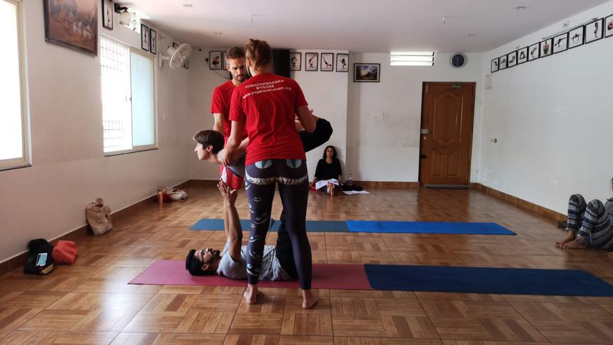 Acro yoga bow pose