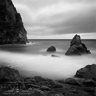 """This tranquil long exposure of smooth breaking white waves on a rocky New Zealand coast introduces our collection of Chip Forelli's landscapes photographs devoid of human presence called """"No Man."""""""