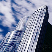 This skyscraper with moving clouds is an example of architectural assignment photography by Chip Forelli.