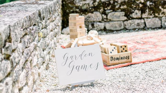 Garden Games hand-painted wooden sign.