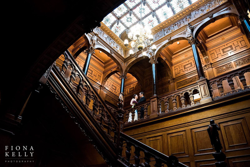 J+A on the grand staircase of Two Temple Place, London
