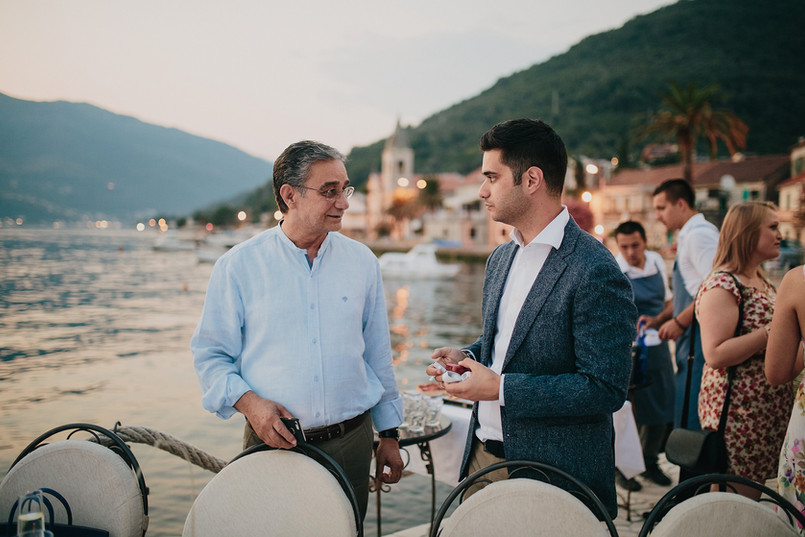 F getting some wise words from dad at his rehearsal dinner - Perast, Montenegro