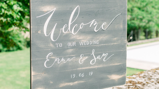Hand painted personalised welcome sign / photo booth back drop.