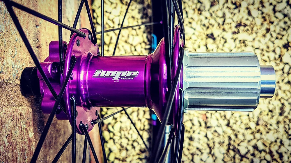Hope Pro 4s with Shimano HG freehub driver in purple with matching Sapim nipples