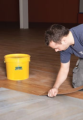 Adhesive for flooring