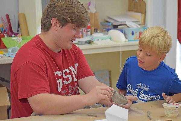 Photo of volunteer helping student