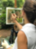 Photo of Barbara Teusink painting plein air