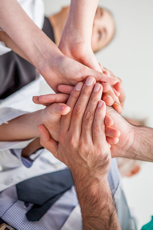 Group of hands together of young busines
