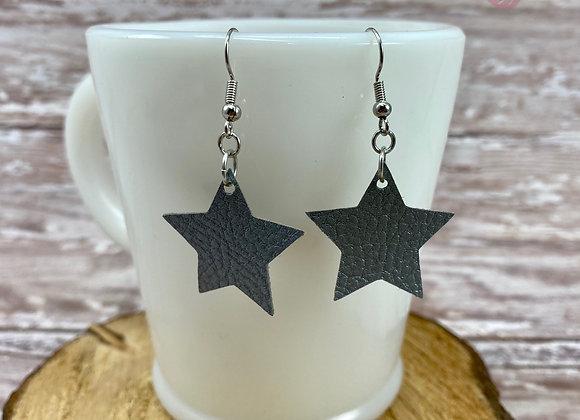 Silver faux leather star earrings.