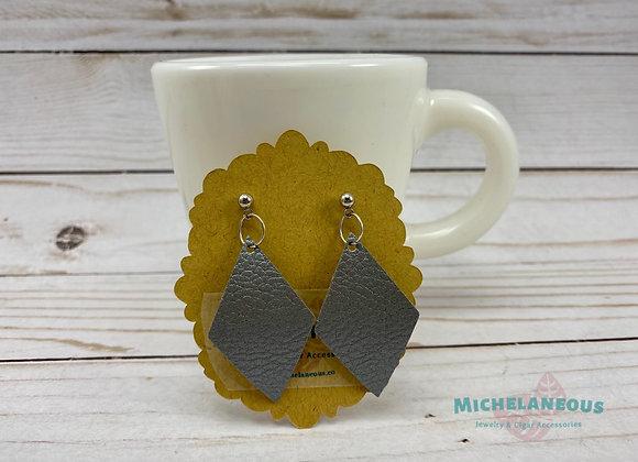 Silver diamond faux leather earrings.