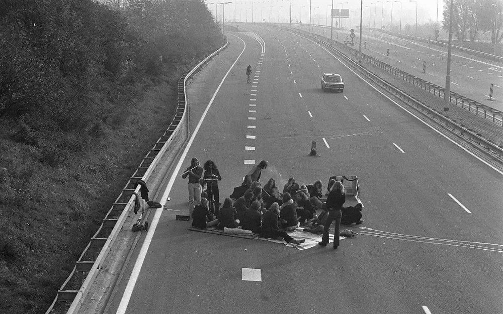 """""""Picnicking on a empty motorway"""" Photograph: Fotograaf Onbekend / Anefo via Guardian"""
