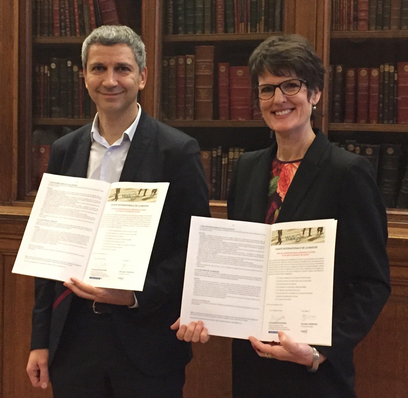 Christoph Najdovski, Vice Mayor of the City of Paris with Bronwen Thornton signing The International Charter for Walking