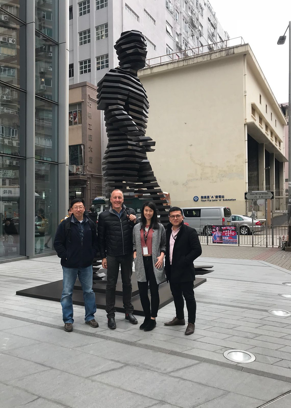 Simon Ng, Jim Walker, Angie Chao and Chris Leung at The Walking Man in Hong Kong, appropriately outside the Mott Macdonald offices