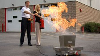 lady using bullex fire simulator trainer