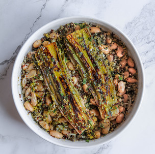 Charred leeks, quinoa & butterbean casserole with capers and lemon