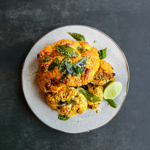 Whole Roasted Cauliflower in Tamarind Coconut Sambal and Fried Curry Leaves