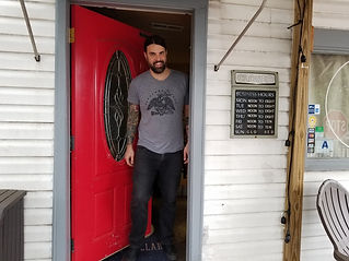 Man standing in the doorway of The Brew Cellar in North Charleston