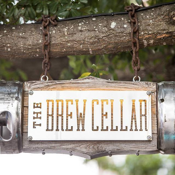 The Brew Cellar logo light on tree over our Park Circle location.