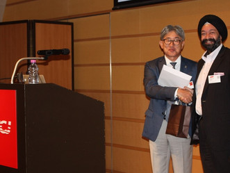 Kiran Sethi presents a certificate of appreciation to Mr. Takaoka, CEO of Nestlé Japan