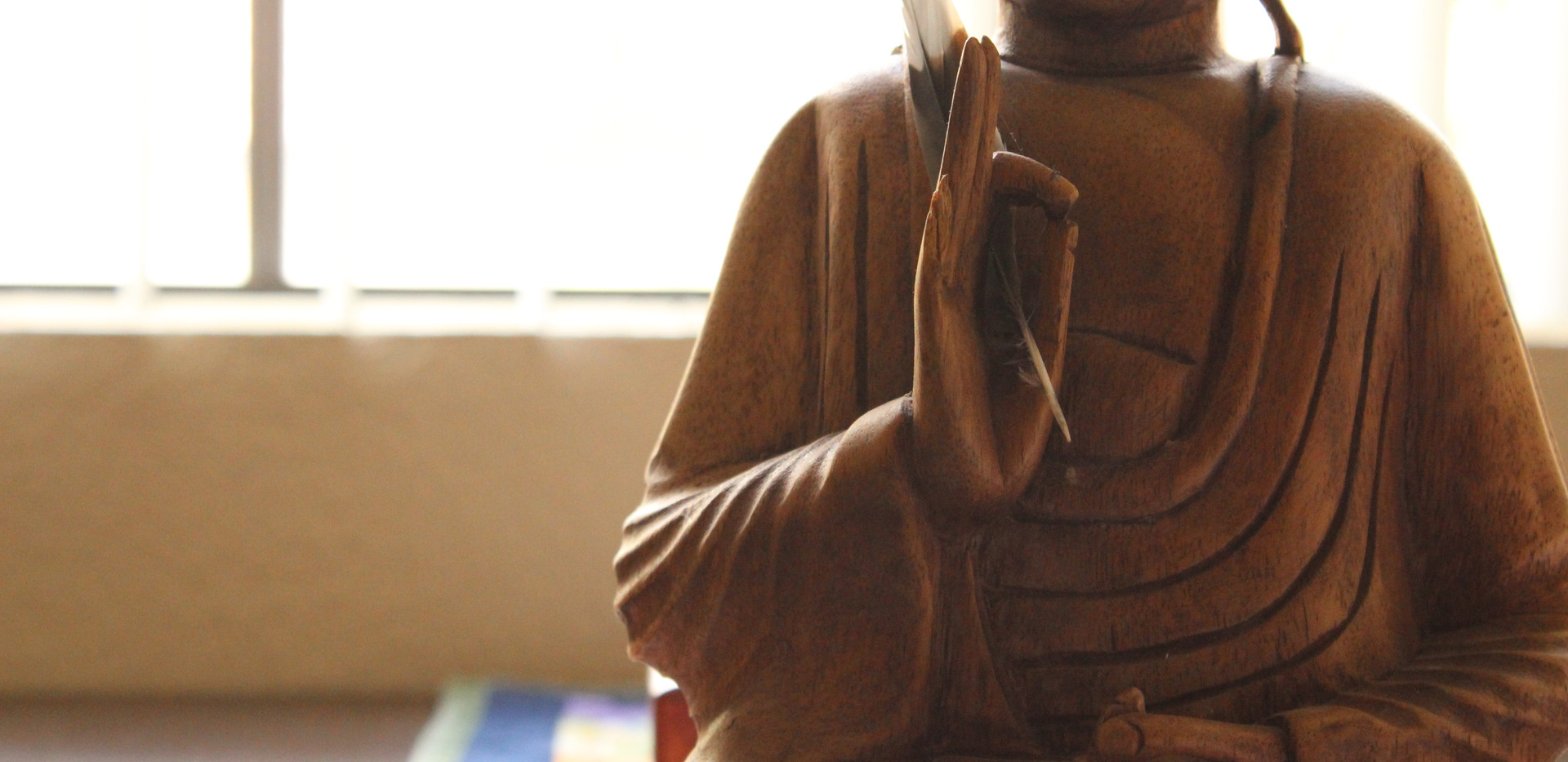 Buddha with a Feather