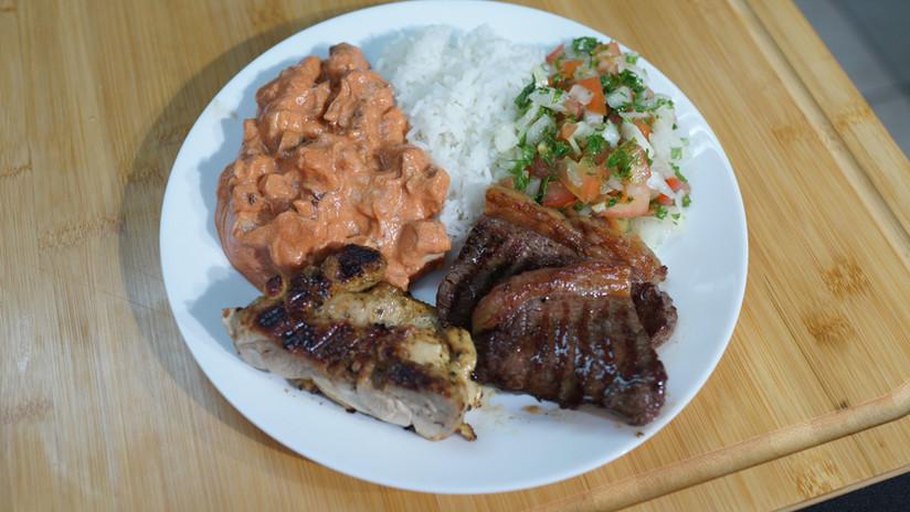 Strogonoff, chicken, beef in a plate