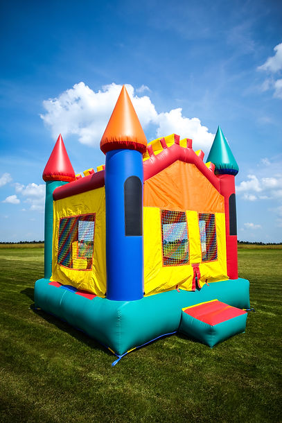 Children's bouncy house castle in a larg