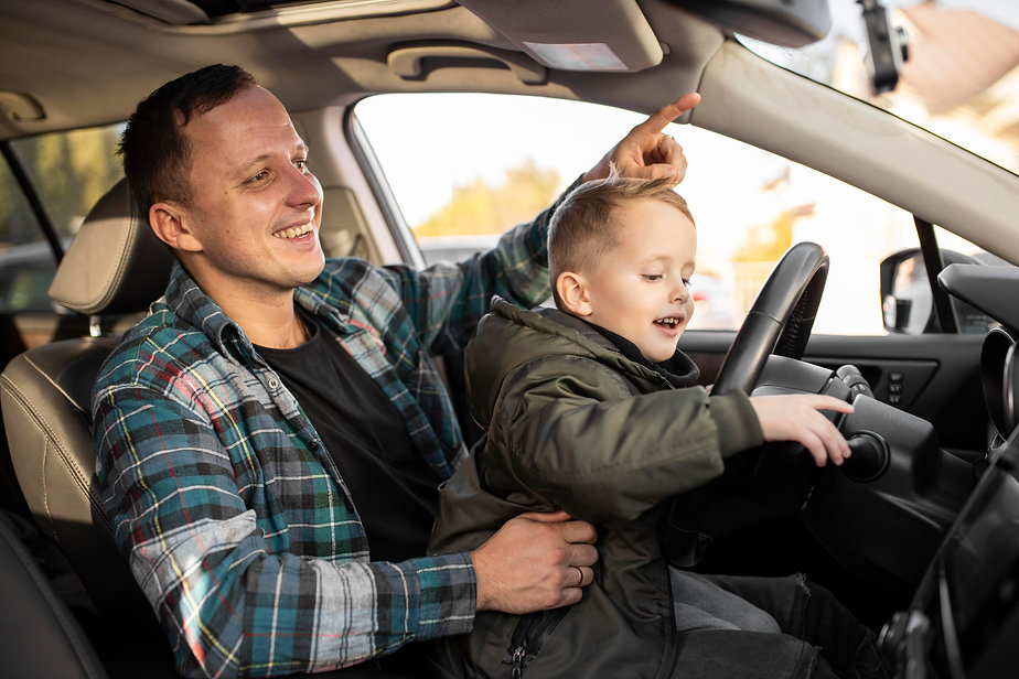 father-son-playing-with-car-wheel.jpg