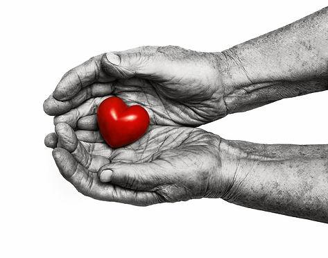 Elderly Woman Keeping Red Heart In Her P