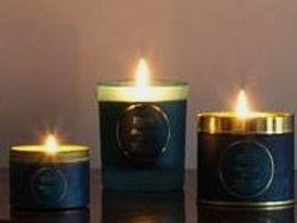 Ambre Noir scented candle set with own travel tin