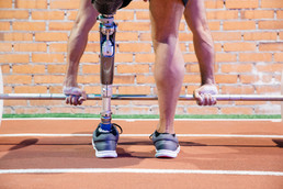 Man with Amputee Lifting Weight