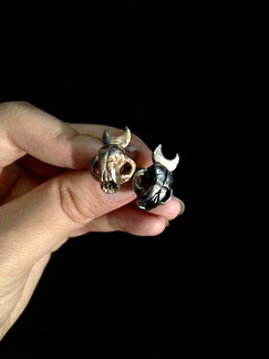 Silver and brass cat skull rings