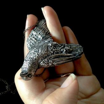 Silver dead bird necklace