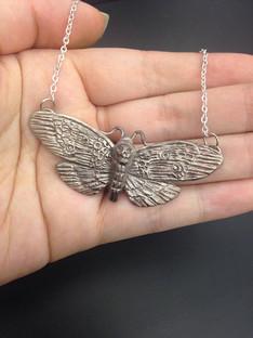 Silver deaths' head moth necklace