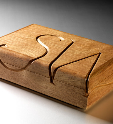 Oak jewellery box with carved initials