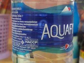 lสัญลักษณ์มาตรฐานการผลิต HACCP ที่ได้รับการรับรองโดย bsi group(thailand) บนฉลากน้ำดื่ม Aquafina