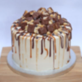 snickers drip mountain cake