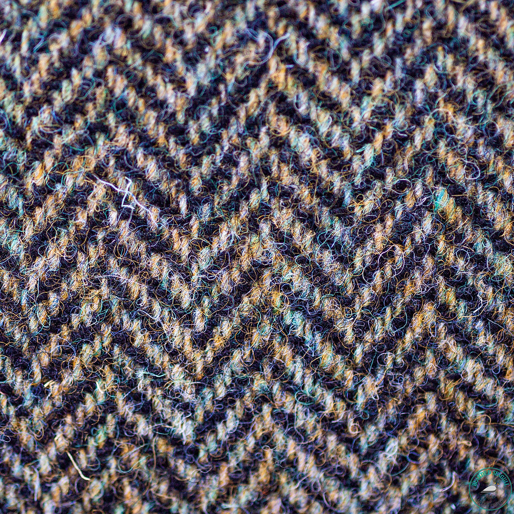 Herringbone pattern weaved into a piece of Harris Tweed