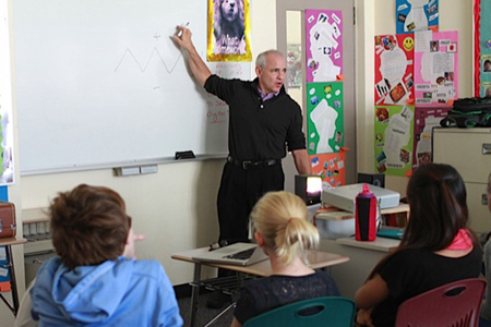 jason talking to elementary students
