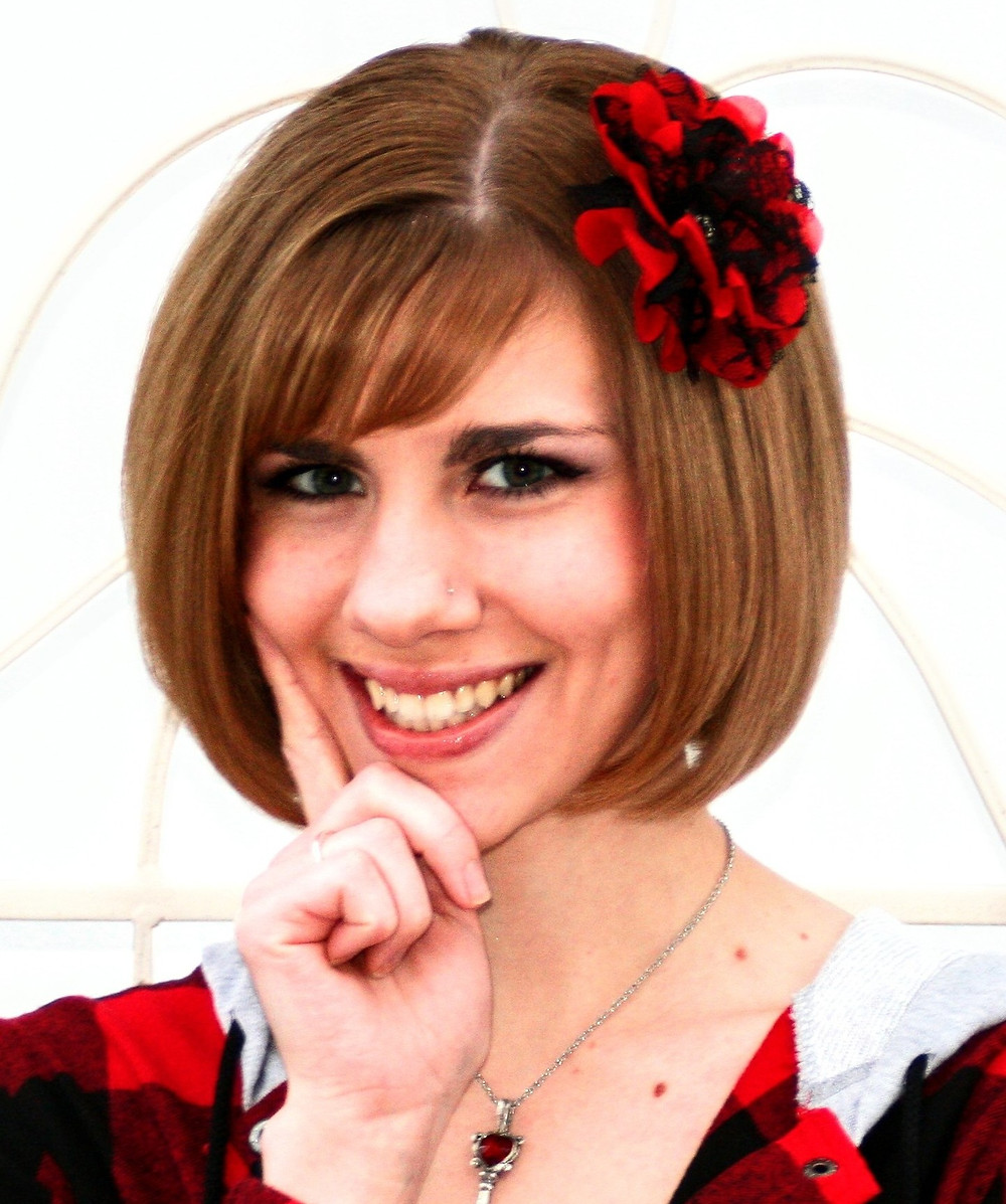 author Kristiana Sfirlea with red rose hairpin